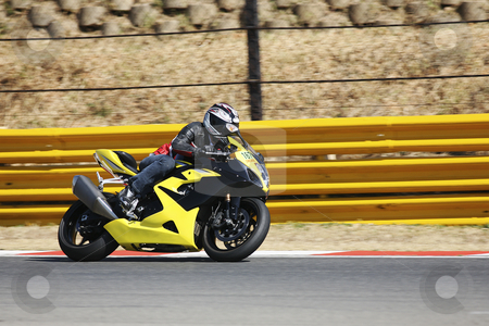 Superbike #64 stock photo, High speed Superbike on the circuit  by Sean Nel
