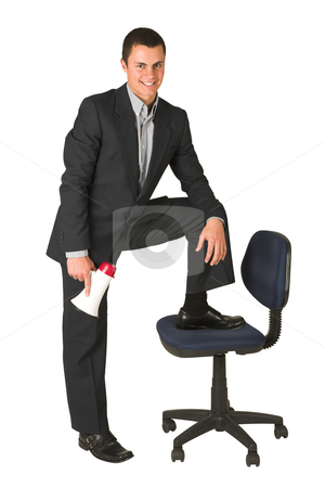 Businessman #252 stock photo, Businessman wearing a suit and a grey shirt.  Making a stunt on an office chair with a megaphone in his hand. by Sean Nel