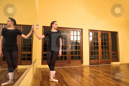 Ballerina #46 stock photo, Ballerina standing next to a mirror by Sean Nel