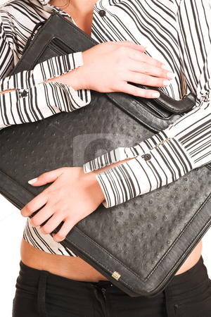 Business Woman #334 stock photo, Picture of hands of a business woman dressed in a white shirt with black stripes. Holding a black leather suitcase. by Sean Nel
