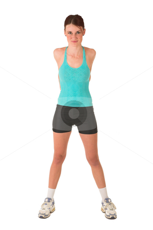 Gym #106 stock photo, Woman standing infront of white background with her hands behind her back. by Sean Nel