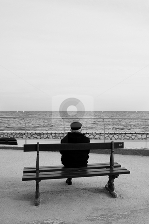 Benchman #04 stock photo, Man on Bench, next to the sea - High Key, Black and White by Sean Nel