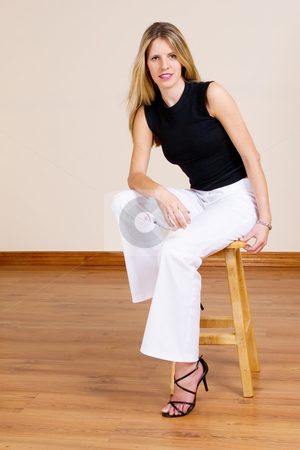Woman #16 stock photo, Beatiful blonde woman sitting on a barstool by Sean Nel
