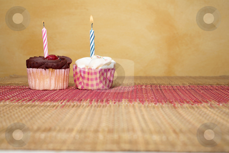 Cupcakes #10 stock photo, Two cupcakes on pink and brown table cloth in front of  wall - copy space by Sean Nel