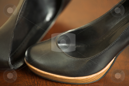 Black Highheel shoes stock photo, Black leather high heeled shoes on a leather shelf by Sean Nel