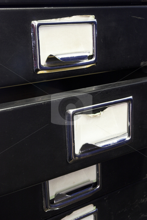 Filing cabinet #2 stock photo, Close-up of a black mini filing cabinet and label with one open drawer by Sean Nel
