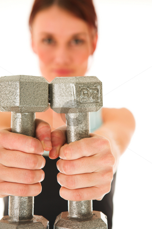 Gym #7 stock photo, A woman in gym clothes, holding weights out in front of her.  Shallow DOF  by Sean Nel