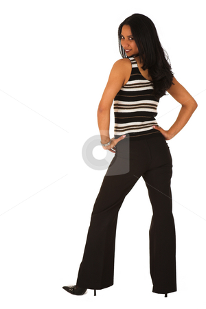 Isolated Sexy Businesswoman looking over shoulder stock photo, Businesswoman with brown hair, dressed in a striped shirt with black suit pants looking over her shoulder and smiling. Shot on White Background by Sean Nel