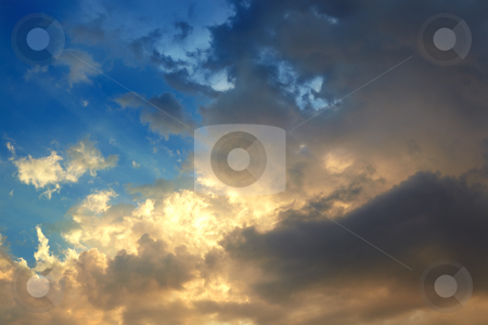 Golden clouds stock photo, Storm clouds with a golden tint of sunset by Sean Nel