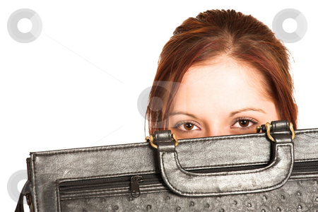 Business Woman #335 stock photo, Business woman with brown hair, peeking over a black leather suitcase by Sean Nel