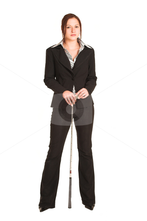 Business Woman #339 stock photo, Business woman with brown hair, dressed in a white shirt with black stripes. Standing, holding a golf putter by Sean Nel