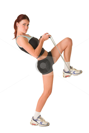 Gym #166 stock photo, Woman in gym wear standing side ways, skipping rope pulling foot up. by Sean Nel