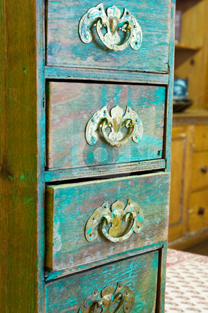Table setting #3 stock photo, Miniature turquois chest of Drawers by Sean Nel