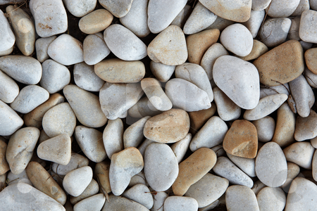 River pebble background stock photo, Light grey and brown smooth river pebble background textured by Sean Nel