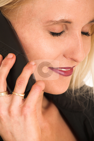 Businesswoman#367 stock photo, Blond Business Woman, eyes closed, talking on phone, smiling by Sean Nel