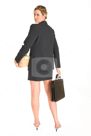 Laura Hopton #16 stock photo, Business woman standing, holding suitcase and potplant, looking over her shoulder - full length by Sean Nel