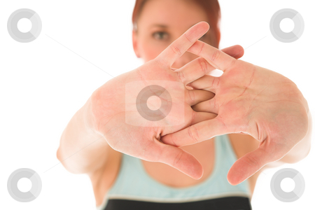Gym #74 stock photo, Woman streching, depth of field, hands in focus, face out of focus by Sean Nel