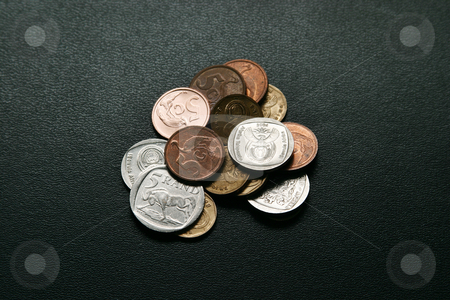 Coins stock photo, Some coins on a black suitcase by Sean Nel
