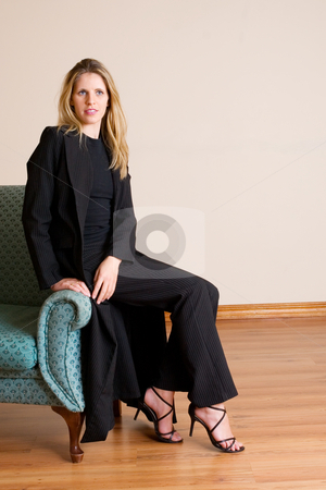 Businesslady #80 stock photo, Blond haired busines woman, sitting on a couch by Sean Nel