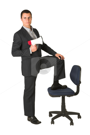 Businessman #251 stock photo, Businessman wearing a suit and a grey shirt.  Making a stunt on an office chair with a megaphone in his hand. by Sean Nel
