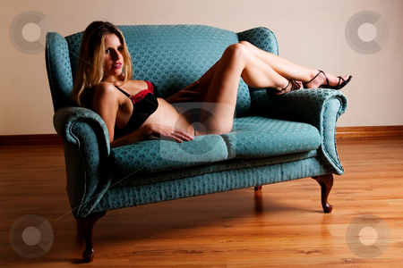 Lingerie #47 stock photo, Beatiful blonde woman lying on couch in Black and Red Lingerie - High Key by Sean Nel