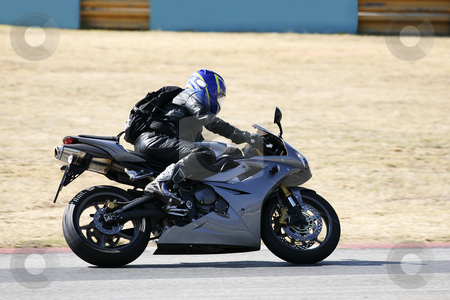 Superbike #71 stock photo, High speed Superbike on the circuit  by Sean Nel