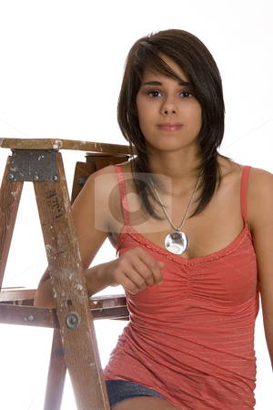 Teen on ladder stock photo, Teen girl sitting on a wood ladder by Yann Poirier