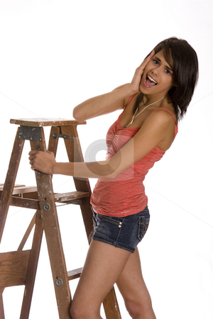 Falling over stock photo, Teenage girl standing on ladder with a surprise expression about the fall over by Yann Poirier