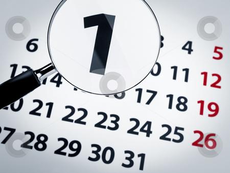 Magnifying glass on a calendar stock photo, A magnifying glass on the 1st day of a calendar page. by Ignacio Gonzalez Prado