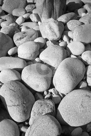 Black and white large granite boulders on the shore in Cornwall UK. stock photo, Black and white large granite boulders on the shore in Cornwall UK. by Stephen Rees