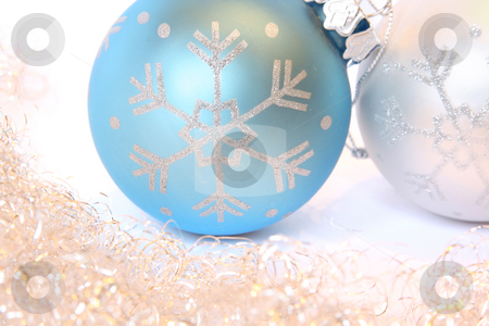 Christmas balls and a tinsel stock photo, Two Christmas balls and golden tinsel. Isolated on white by Olga Lipatova