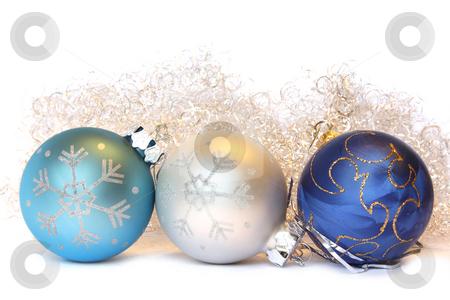Christmas balls and a tinsel stock photo, Three Christmas balls and golden tinsel. Isolated on white by Olga Lipatova