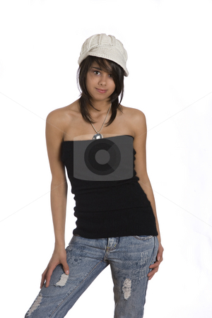 Teenage girl stock photo, Teenager girl wearing a black tube top, knitted hat and jeans by Yann Poirier