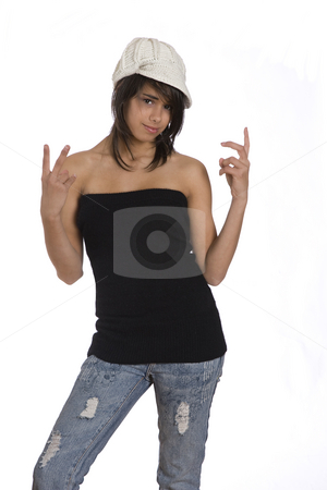 Peace out stock photo, Teenager girl pulling in tube top, jeans and knitted hat doing peace sign by Yann Poirier