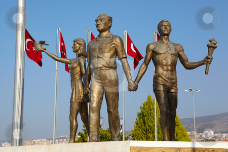 Ataturk peace monument stock photo, Monument of Ataturk and Youth, Kusadasi, Turkey with Turkish flags in the background. The monument signifies peace and hope by Sean Nel