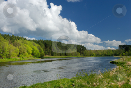 Clouds over the river  stock photo, Vilija in the spring afternoon, clouds in the sky over the river by Vladimir Blinov