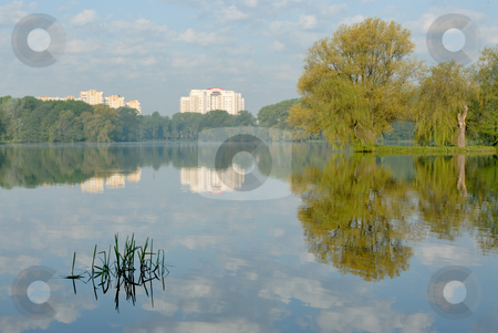 Morning in a city stock photo, Morning on lake in Minsk, the first beams of the sun. by Vladimir Blinov
