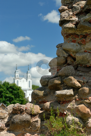 Old stones stock photo, The rests of a wall of the castle in Krevo and church nearby. by Vladimir Blinov