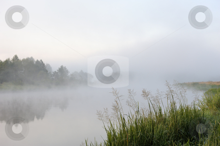 Morning river mist stock photo, The sunrise, over the river rises a morning fog. by Vladimir Blinov