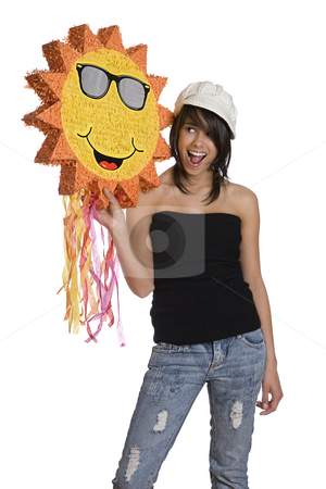 Happy sunny teen stock photo, Teenage girl wearing a black tube top, knitted hat and jeans with holes holding a sunny pinata by Yann Poirier