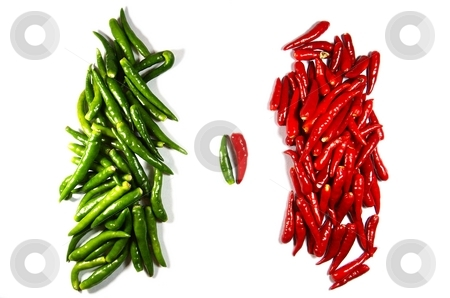 Opposition of two heaps of chili papers stock photo, Opposition of two heaps of chili papers. isolated on white by Oleg Blazhyievskyi