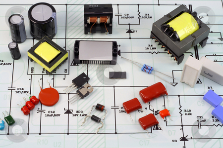 Electronic components and the electric scheme stock photo, Electronic components and spare parts - resistors, capacitors, diodes, transformers, transistors, microcircuits and so on. Elements are located on the electric scheme. by Aleksandr Volokov