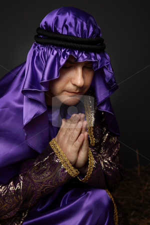Worship and prayer stock photo, Holy man bent down in prayer by Leah-Anne Thompson