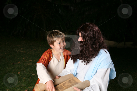 Learning the scriptures stock photo, A happy child discusses the scriptures with an adult, rabbi or other religious person. by Leah-Anne Thompson