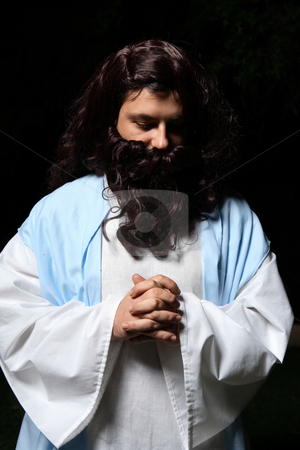 Praying man stock photo, Biblical or middle eastern man head bowed and praying by Leah-Anne Thompson