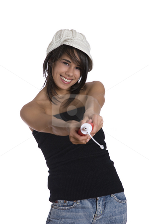 Spraying ketchup stock photo, Teenage girl wearing a black tube top, knitted hat and jeans with holes squeezing a ketchup bottle by Yann Poirier