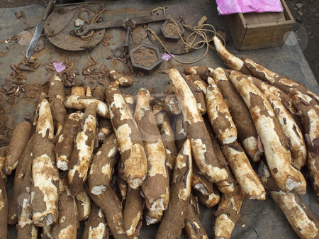 Tapioca roots for sale stock photo, Tapioca roots and weights munnar market south india by Mike Smith