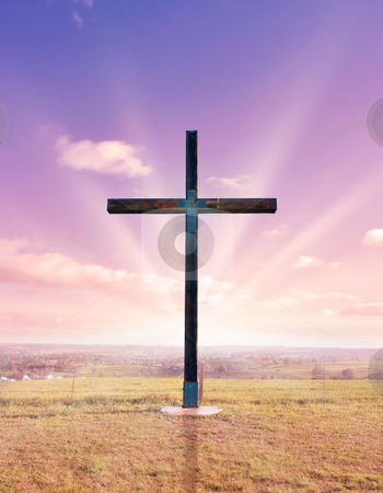Cross of christ at sunset or sunrise stock photo, Cross of christ in field at sunset or sunrise by Phil Morley
