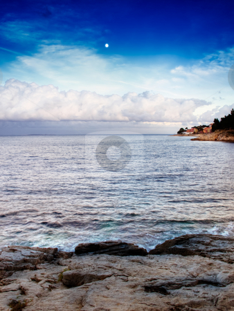 Clouds over sea stock photo, Cumulus in the distance above the horizon of the Adriatic Sea by Sinisa Botas