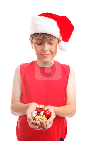 Chocolates stars stock photo, A boy holds a handful of festive gold, silver and red foil wrapped chocolate stars by Leah-Anne Thompson